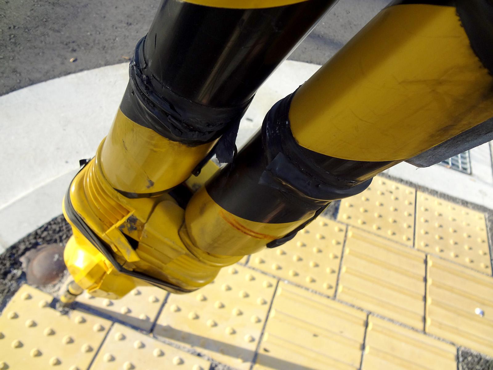 Yellow power line and sidewalk